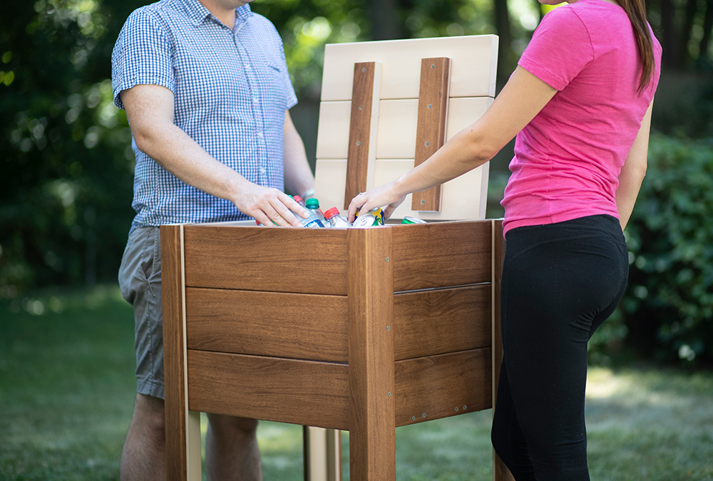 man and woman standing by cooler