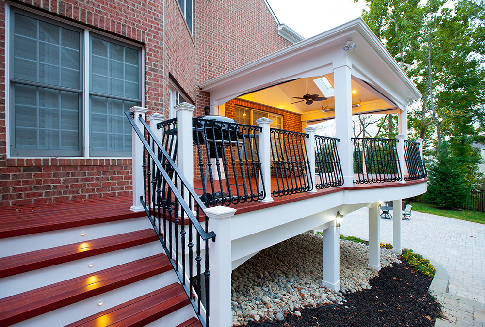red stained porch metal railing