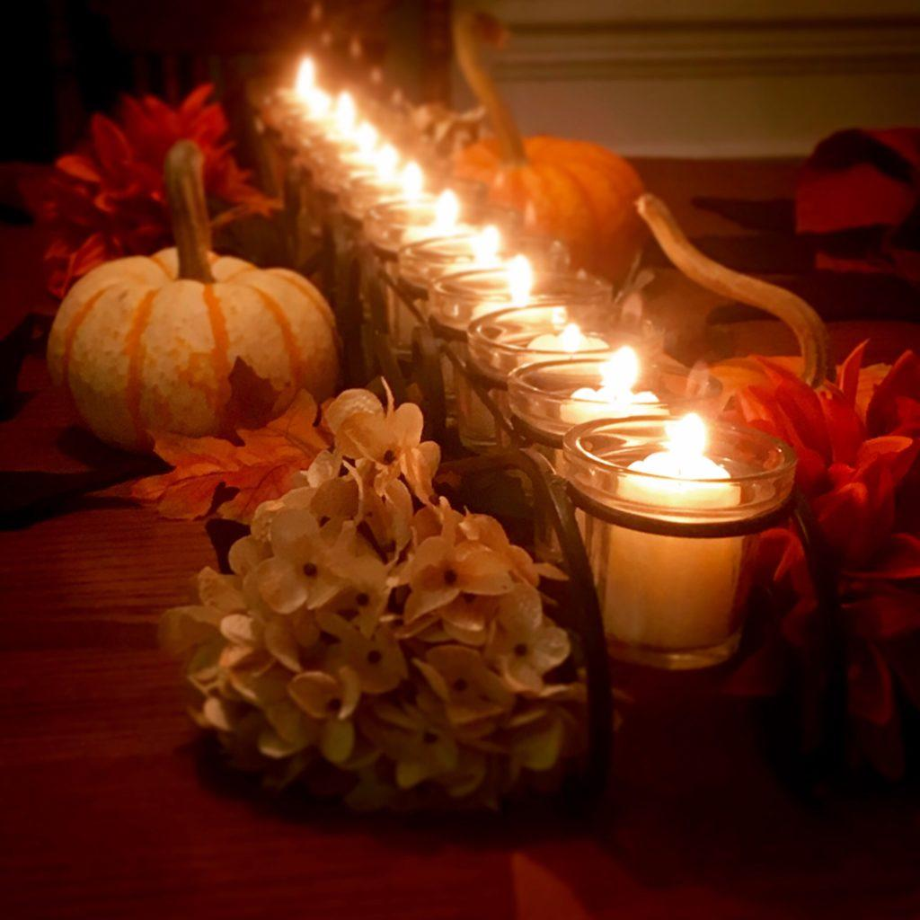 candle centerpiece with pumpkins