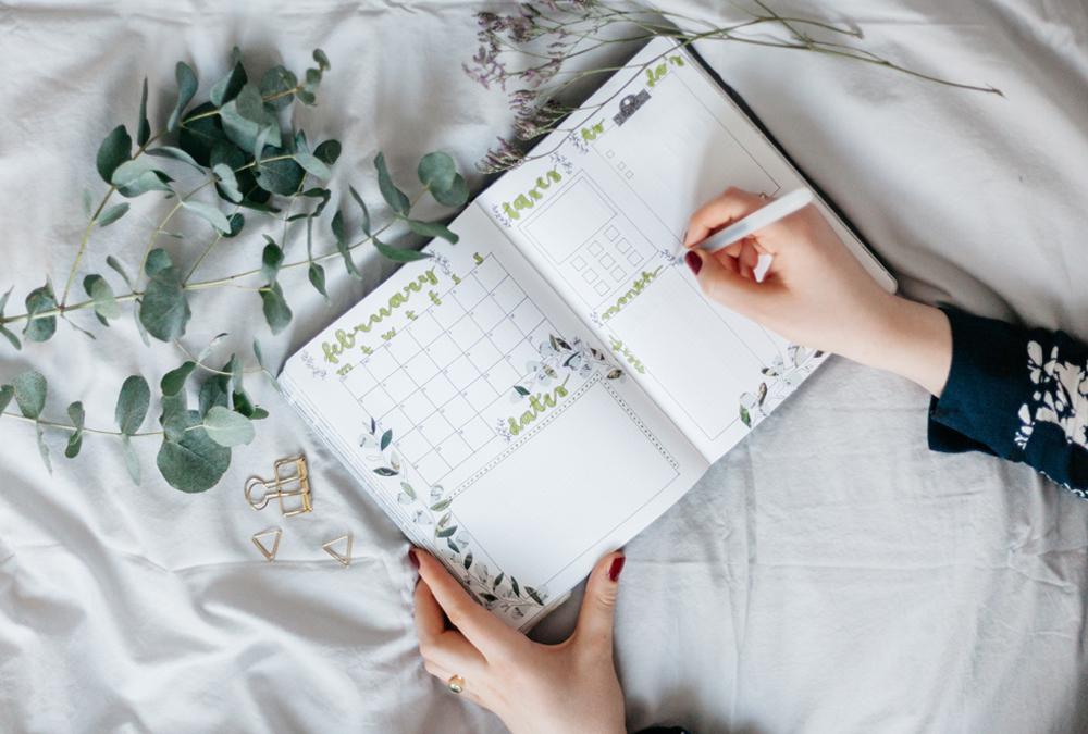 writing in a calendar planner