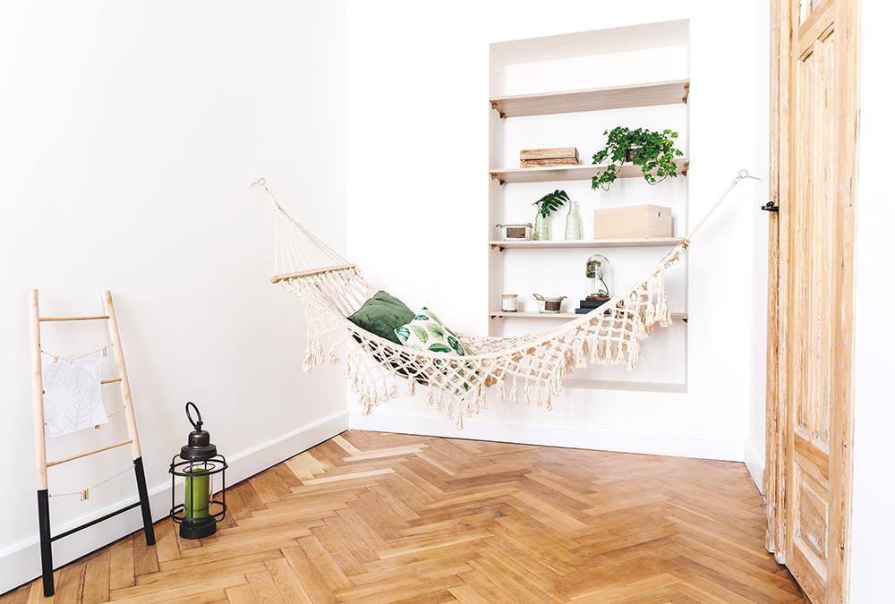 room with bookshelf and hammock