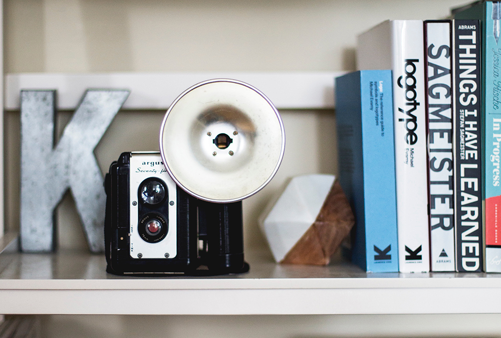 camera and books on shelf