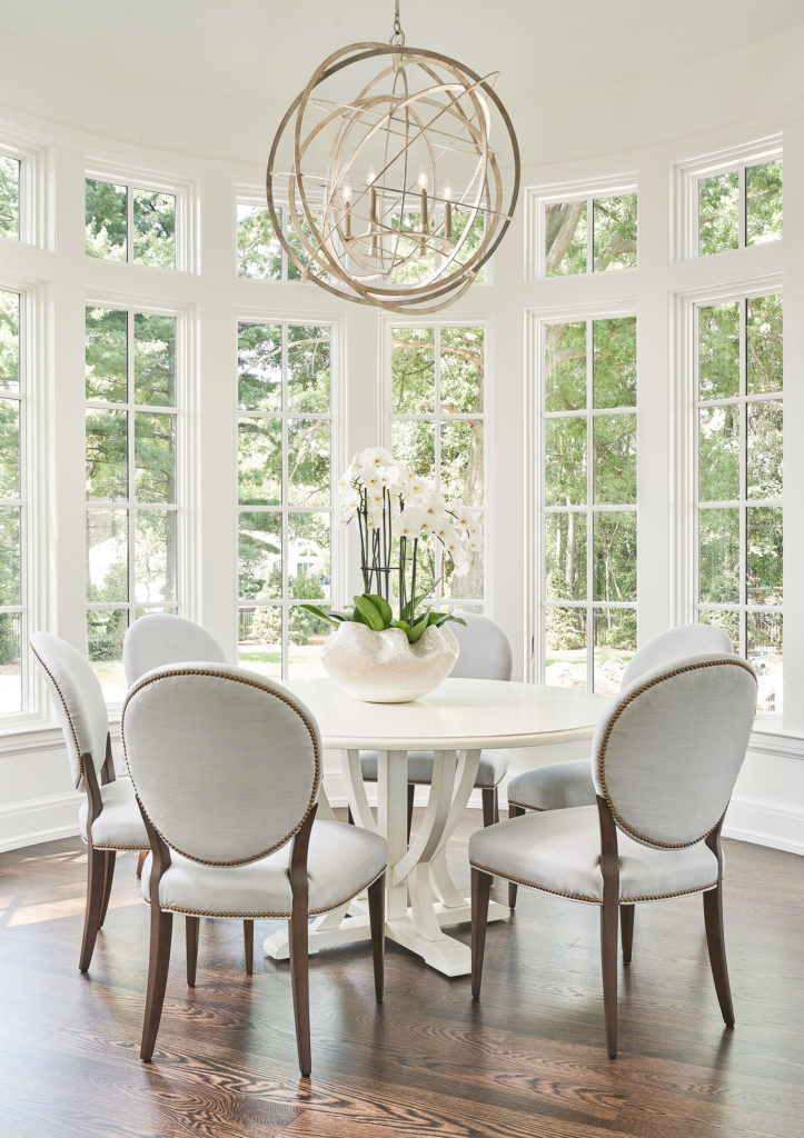 Bright dining area with globe chandelier