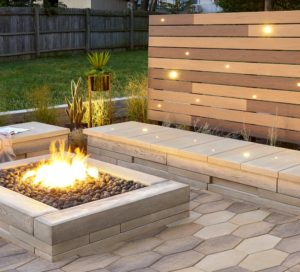 fire pit and stone bench with lighted panel